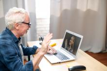 elderly man on computer chatting with granddaughter